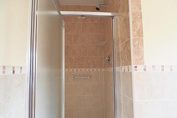 Separate bathroom with shower ground floor